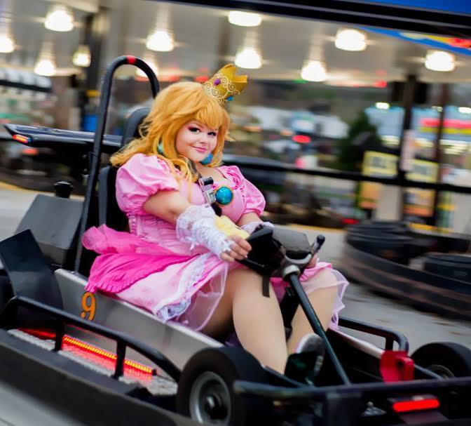 Princess Peach cosplayer riding on Go Kart